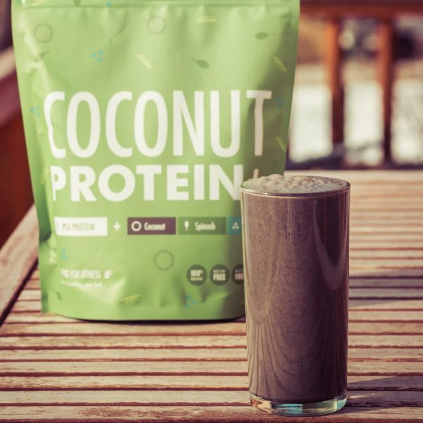 A glass of Organic Plant Coconut Protein+ mixed with coconut water and chia seeds